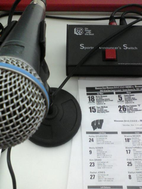 Pictured: the tools of a hockey PA announcer's trade--mike, mike switch, and line charts.